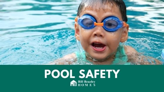 An image of a kid with goggles in the pool.