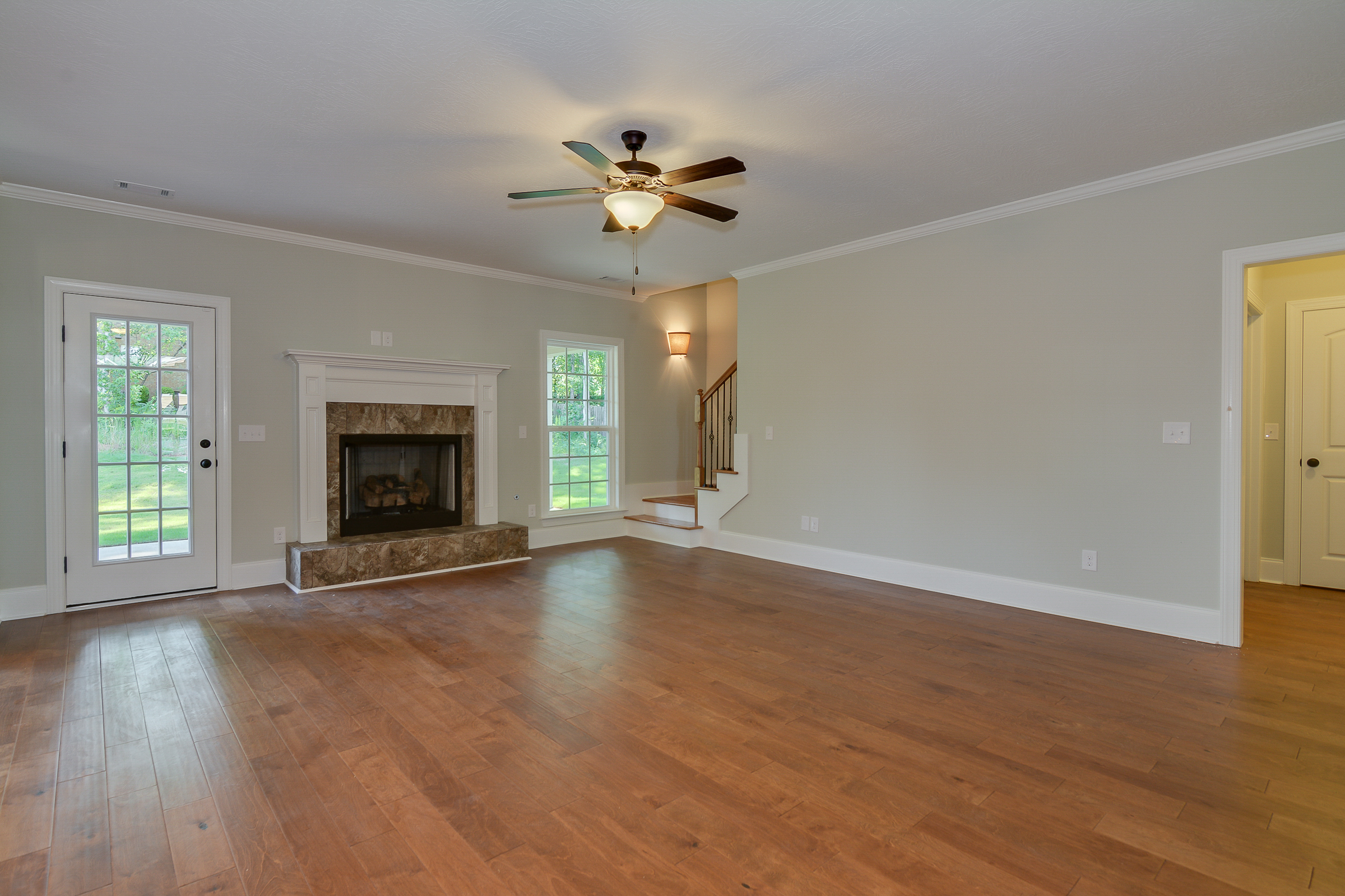 An image of living room with fireplace in Bergen Place West Home.