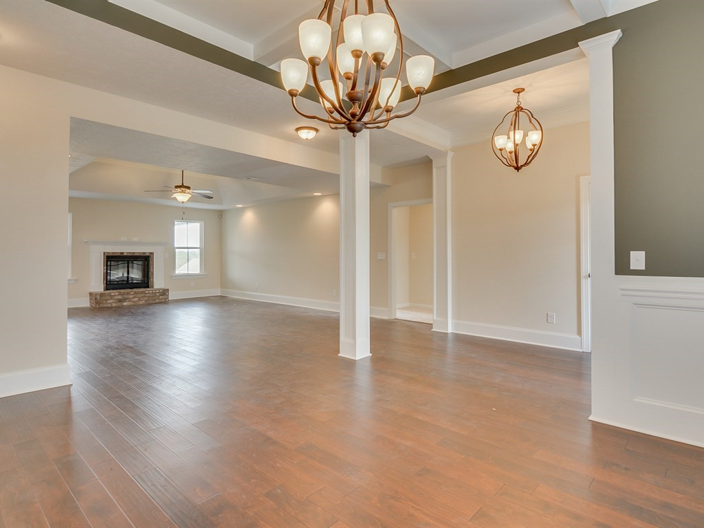 An image of the formal dining room looking into living room in haynes station.