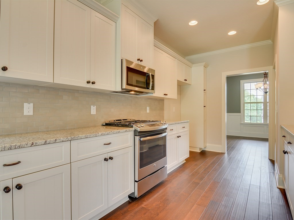 An image of the kitchen next to the formal dining room at a home in the Retreat.
