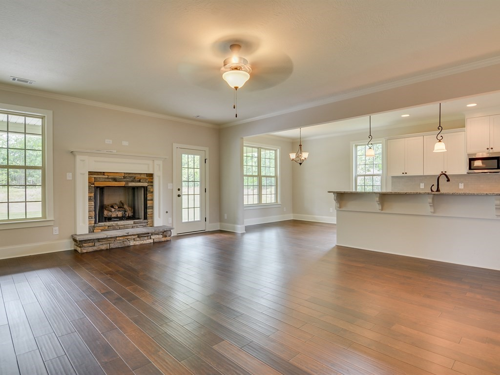 An image of the open living room and kitchen at a home in The Retreat.
