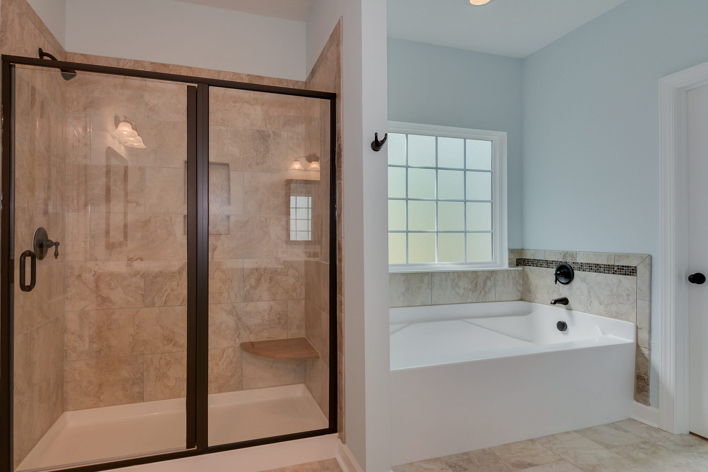 An image of the walkin shower and bath at Bergen place West Home.