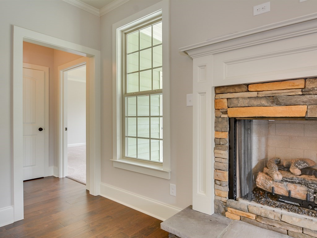 An image of the fireplace of a home at The Retreat.
