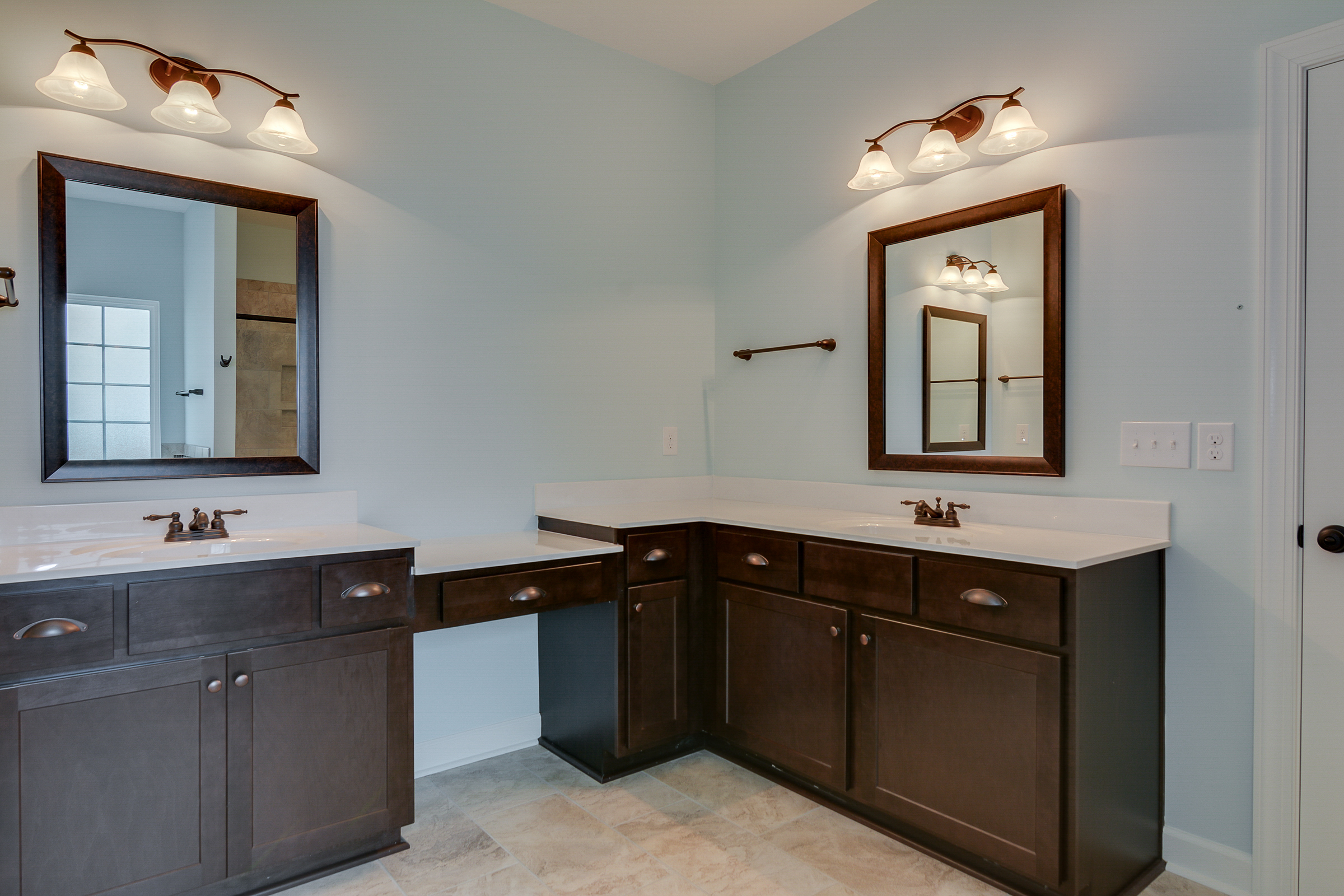 An image of his and her sinks at Bergen Place West Home.