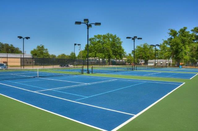 An image of tennis courts near The Retreat.
