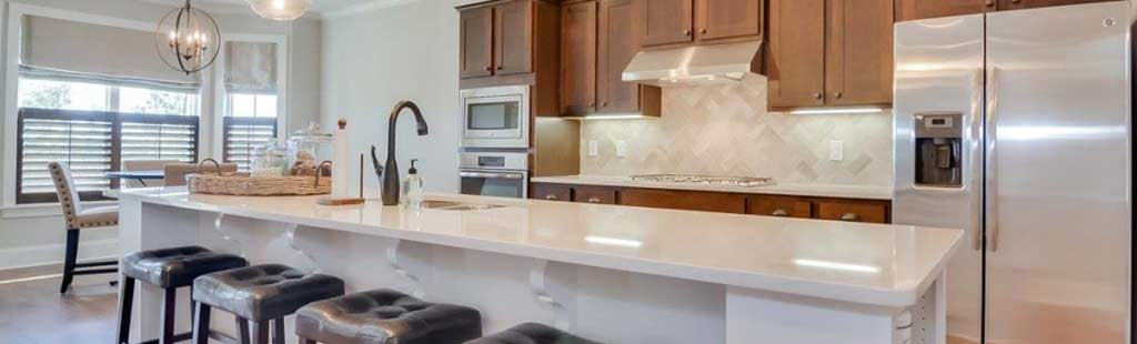 An image of a kitchen with breakfast bar.