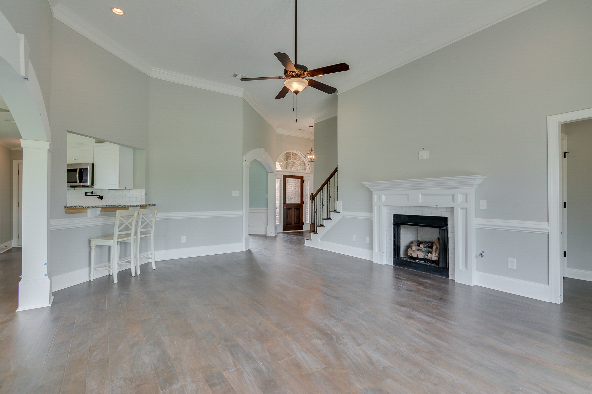 An image of a living room with high ceiling in Kelarie home.