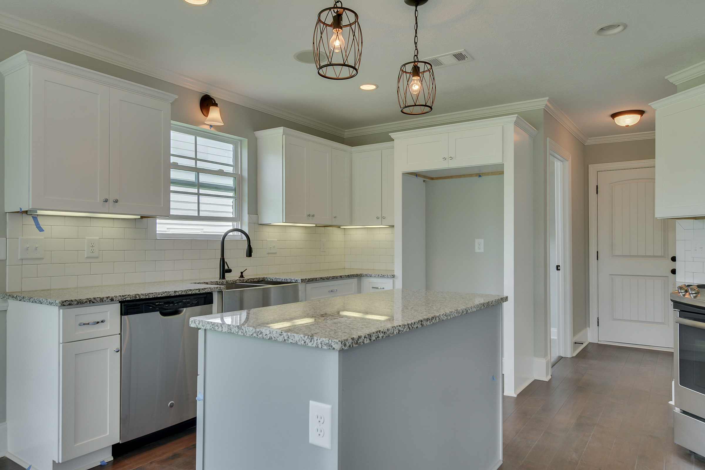 An image of a kitchen with decorative lighting in Kelarie home.