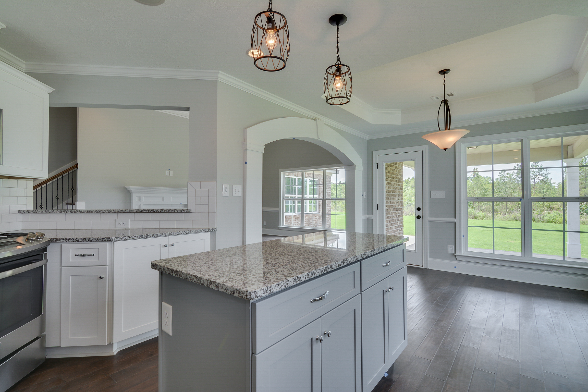 An image of a kitchen with an island and a view in a kelarie home.