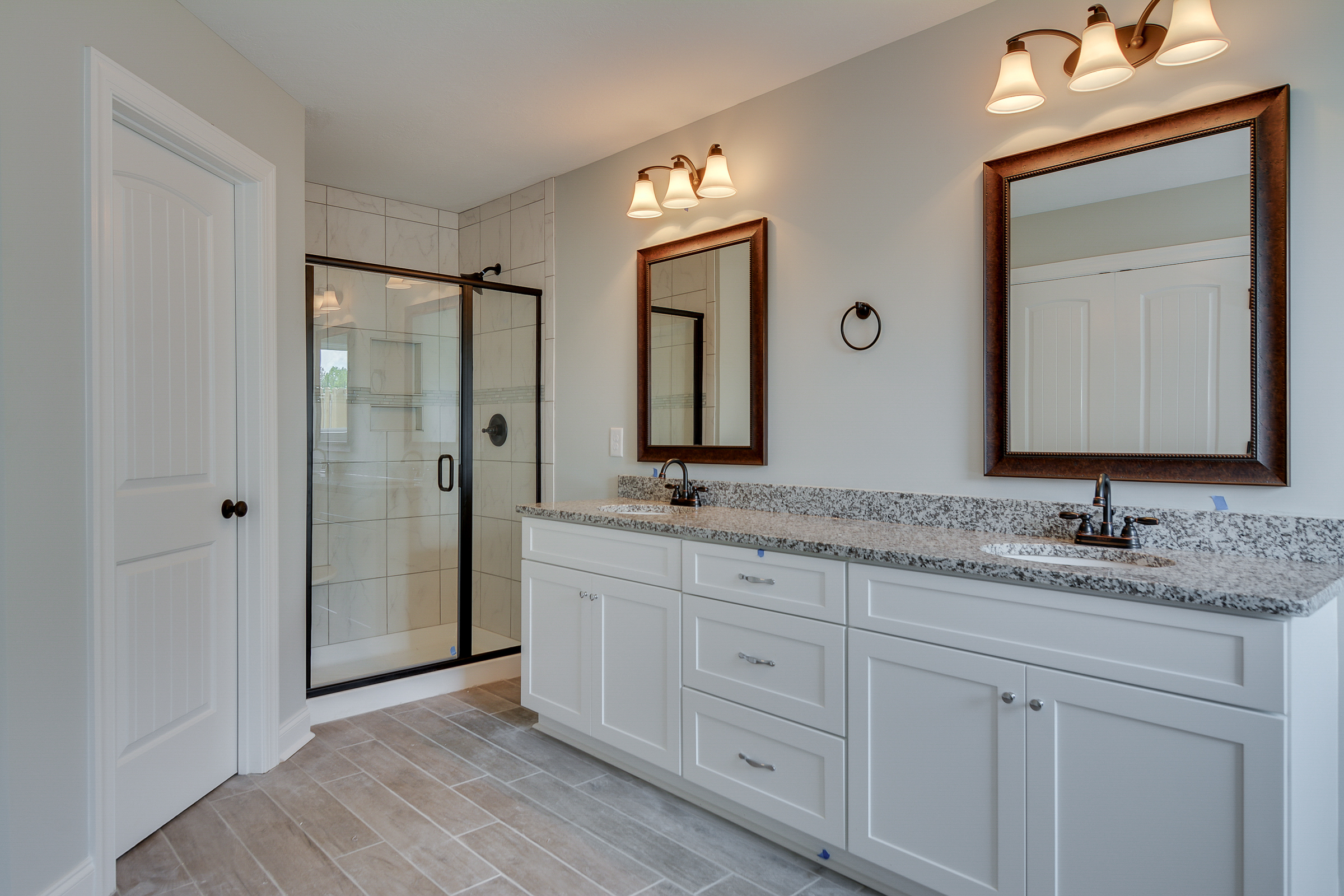 An image of a bathroom with walk in shower in a Kelarie home.