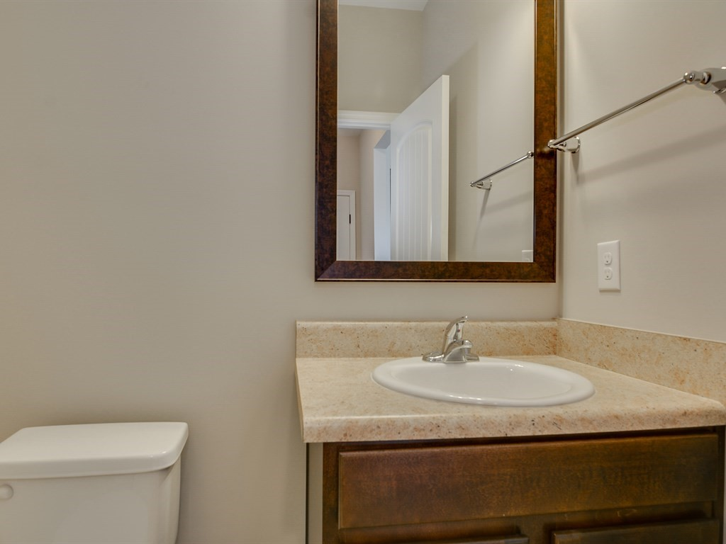 An image of the guest half bath in Southhampton Home.