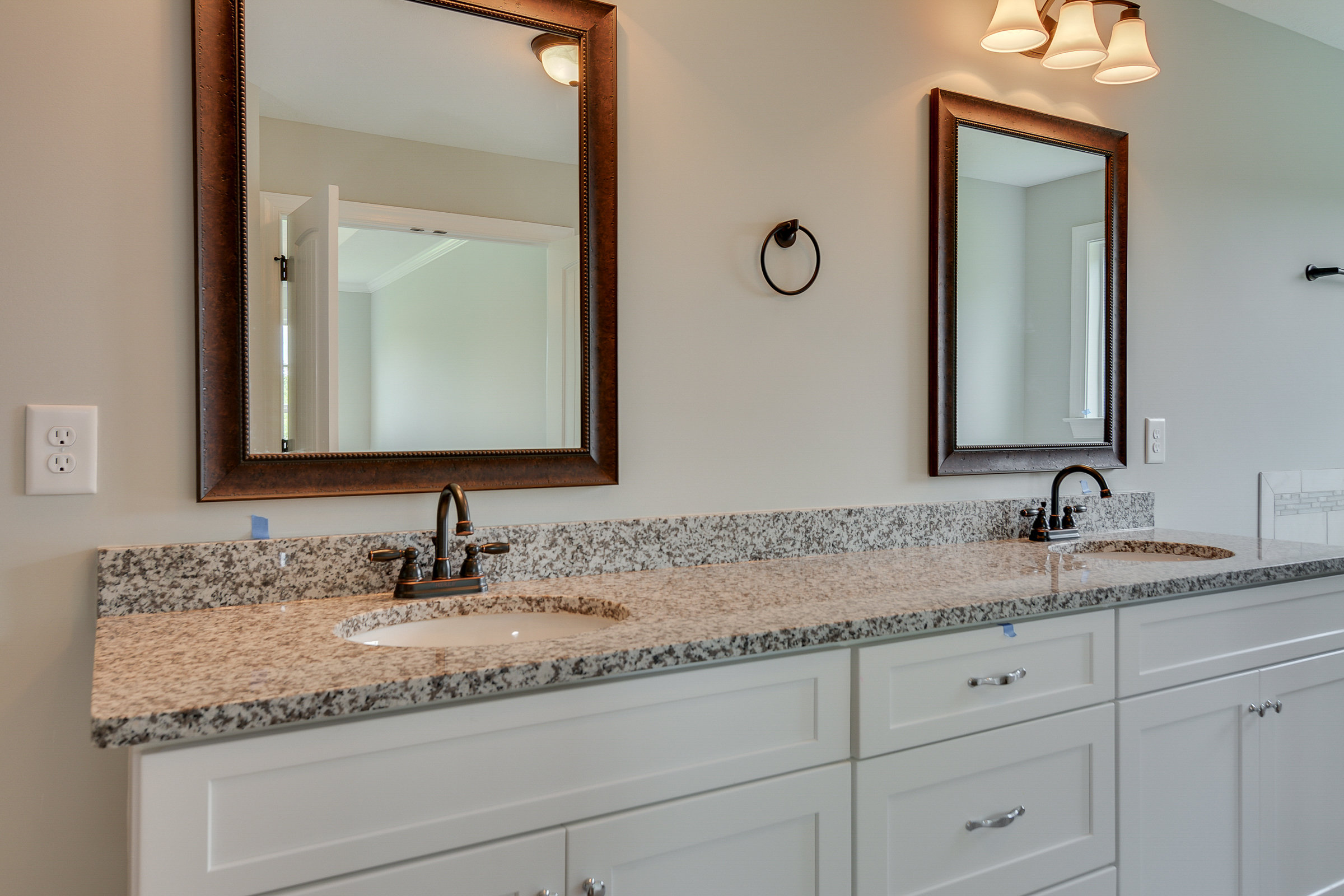 An image of his and her sinks with mirrors in Kelarie home.