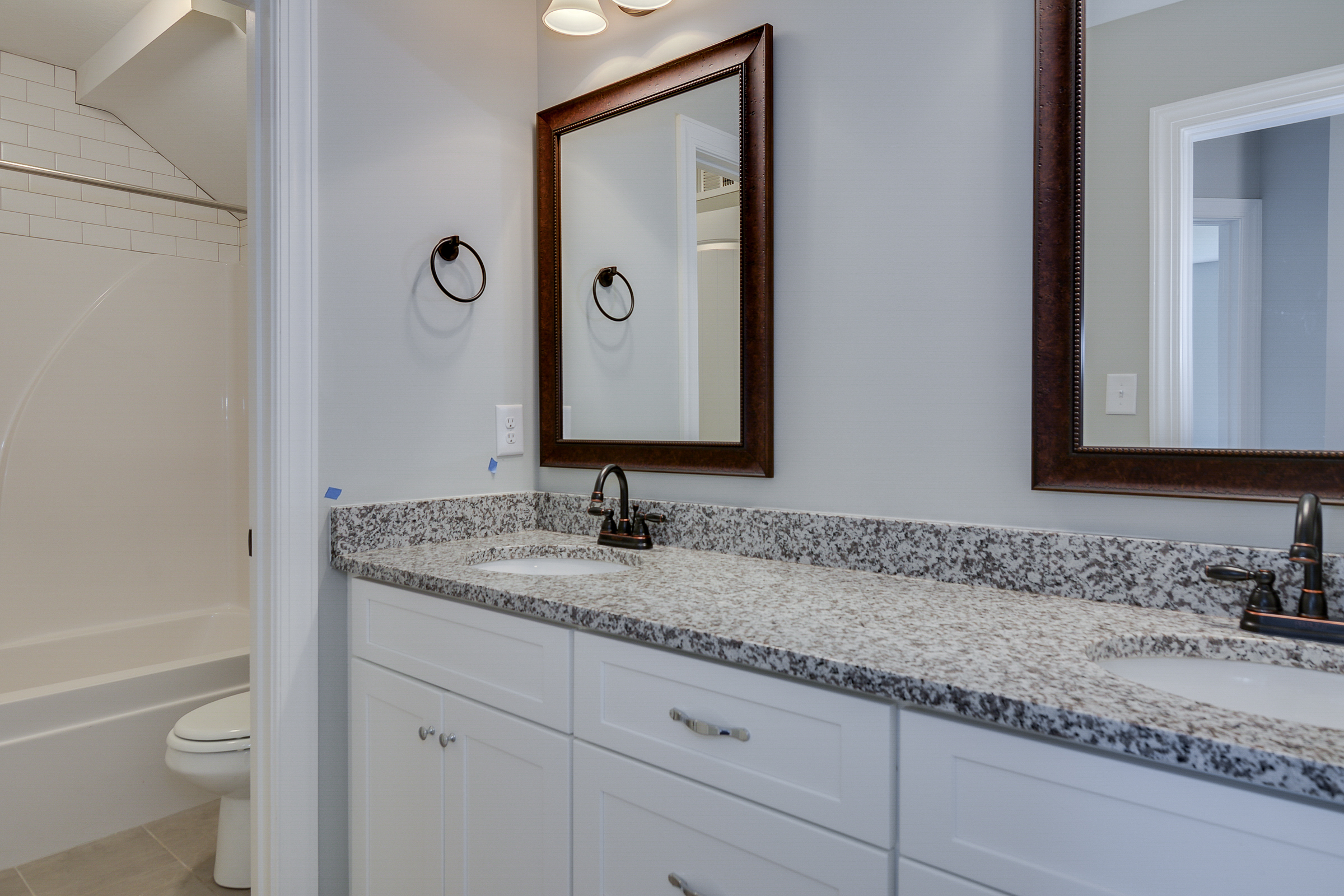 An image of a his and her bathroom sink with marble countertop in Kelarie.