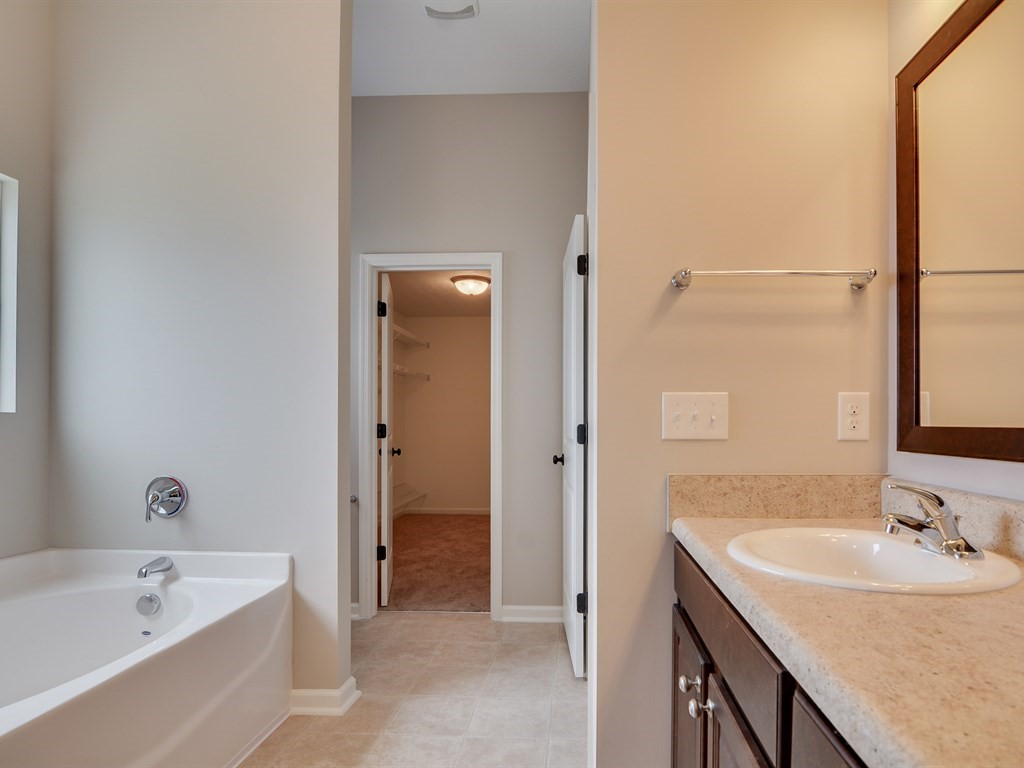 An image of the bathroom in Southhampton home with walk in closet.