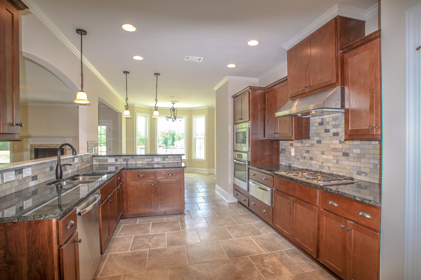 An image of a Kelarie home kitchen with tile and wood.