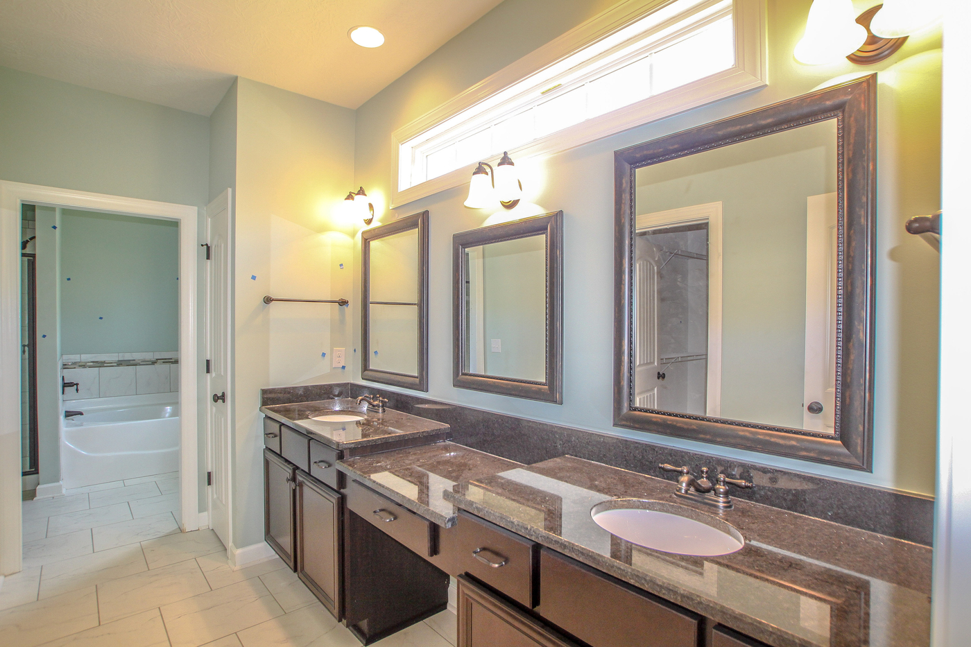 An image of a master bathroom with his and her sinks.