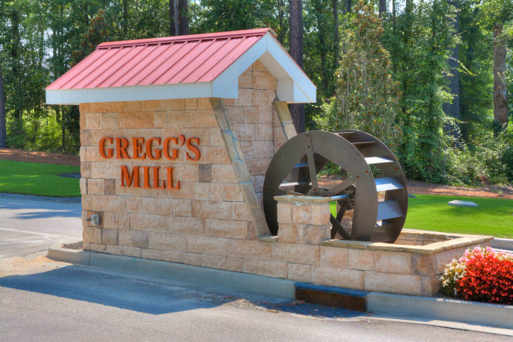 An image of the Gregg's Mill front entrance sign from a side view.