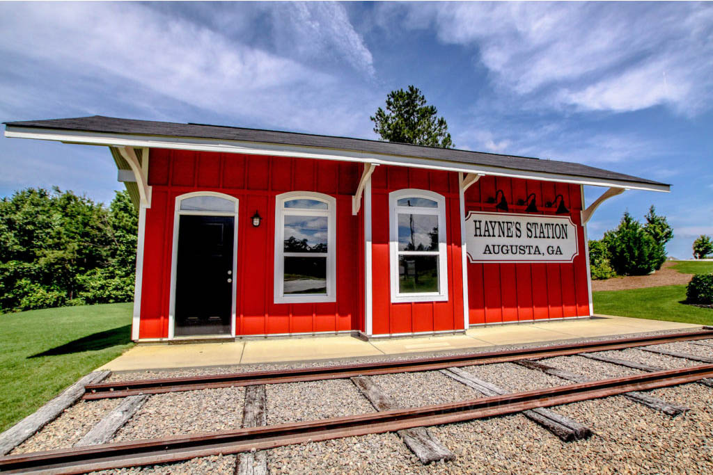An image of the Haynes Station railroad building with tracks.